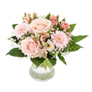 Blombukett i varma rosa färger